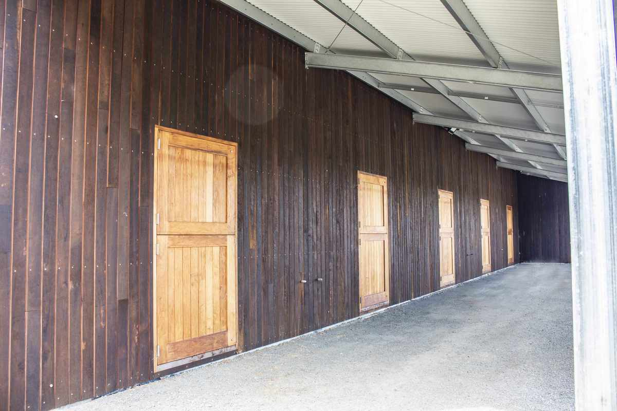 Covered horse stable with doors