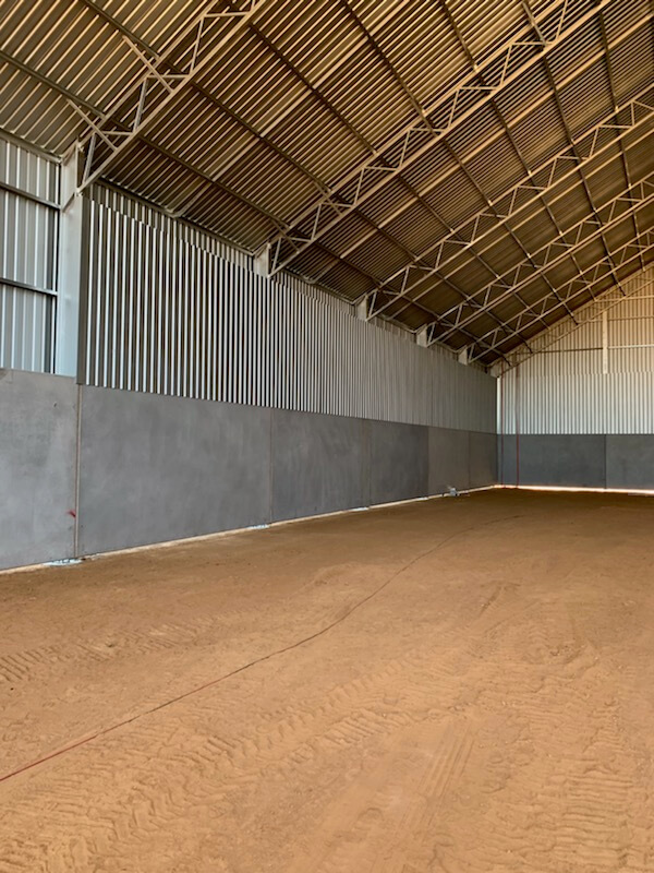 Inside grain shed in Merah North